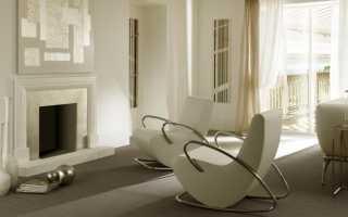 Кресло качалка у камина в интерьере